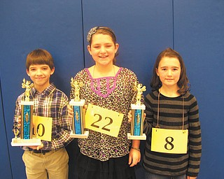 "Fourth-grade spelling champs: Hubbard Elementary School had its fourth-grade spelling bee Jan. 13. The first place finisher was Nathaniel Arthur, left, who successfully spelled the word ""blatant."" Finishing in second place was Laney McCallister, center, followed by MacKenzie Hurd, right, who took third place. Nathaniel will represent the school in the Trumbull County and The Vindicator spelling bees."