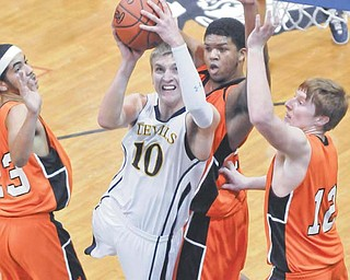 McDonald's Christian Rusinowski (10) muscles up a shot over Wellsville's Seth Bradford, right, Jordan Sloan,