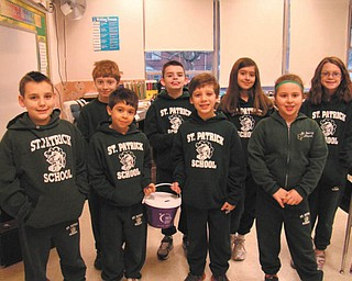 Students at St. Patrick School in Hubbard are preparing for their annual American Cancer Relay for Life. A loose change contest among classes generates additional funds for this cause and earns the class that takes in the most money a pizza/ice cream party. Members of the school's fourth-grade class are, front row, from left, Michael Hammand, Jordan Serrano, J.J. Scarmuzzi and Katie Cigollie; back row, from left, Simon Yesh, Cooper Muccio, Olivia Robinson and Regan Sandy.