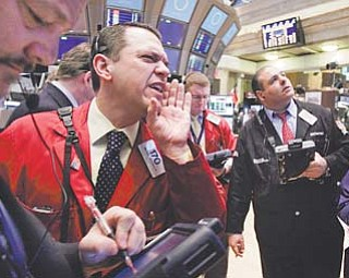 Trader Michael Zicchinolfi , second from left, works on the floor of the New York Stock Exchange on Wednesday.