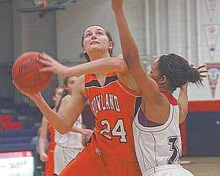 Howland's Taylor Williams (24), under pressure from Fitch's Brianna Edwards (34), prepares to shoot during an All-American Conference basketball game Thursday in Austintown. Williams, a 1,000 point scorer and reigning second team all-Ohio honoree who is headed to Princeton University, posted 16 points and grabbed nine rebounds to help lead the Tigers over the Falcons, 54-38.