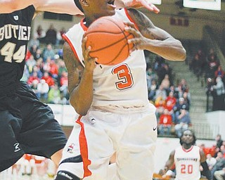 Kendrick Perry (3) of Youngstown State is fouled by Butler's Andrew Smith (44) as he goes in for a layup during