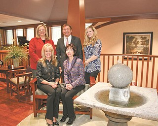 Robert K. Yosay | The Vindicator: Hospice of the Valley will sponsor a benefit Mardi Gras Party on Saturday. Some of those involved in the preparations are, seated, from left, Caryn Covelli and Denise DeBartolo York. Standing are Liz McGarry, Sam Covelli and Shannon Monstrola.
