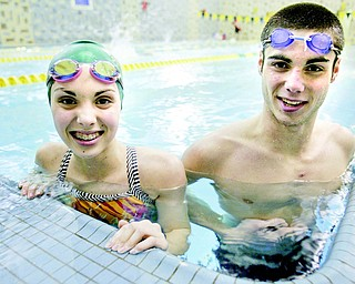 Cardinal Mooney swimmers Annie and Joe Boniface practice in the pool at the YMCA in Youngstown. The Cardinals did not have a swim team until eight years ago when the siblings' older brother Tom proposed the idea.