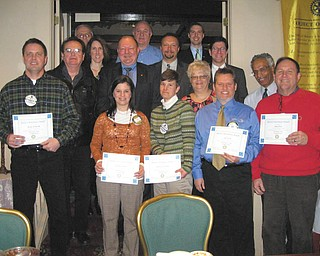 Austintown Rotary President Deanna Spirko recently presented certificates acknowledging three months of perfect attendance to 16 members, almost half of the club membership. Recipients of the award are, left to right, front row, Spirko, Hillary Prestridge, Robin Stock, Karl Rein, Ram Kasuganti and Gary Reel. Middle row: Brian Frederick, Ron Carroll, Jen Connolly, Chuck Baker, Mark Cole and Mitch Dalvin. Back row: Tony Cebriak, Mal Culp and Brian Laraway. Absent from the picture is Jerry Haber.