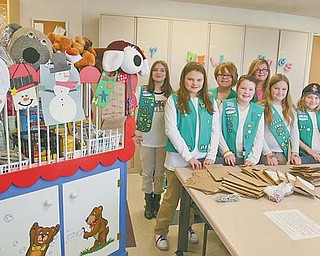 The junior Girl Scouts of Liberty-based Troop 80055 donated craft kits Monday to Akron Children's Hospital Mahoning Valley in Boardman. Pictured in the front row, from left, are Julia Sammartino, Rebecca Horn, Gwen Carlson, Zoe Franklin and London Hairston. In the back row, from left, are Brittany Horn, Kaylin Johnson and Kimberly McCann.
