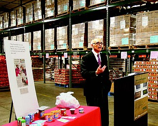 Michael Iberis, executive director of Second Harvest Food Bank of the Mahoning Valley, talks about the Feeding America BackPack Program the food bank sponsors at elementary schools in Warren, Campbell and Struthers. The BackPack initiative provides food for children to take home on weekends.