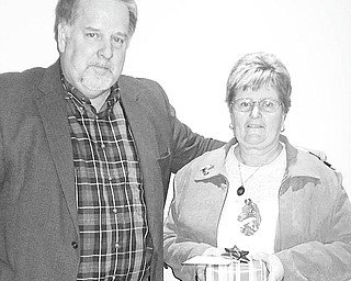 The Columbiana County Fair Board honored Julie Herron on Jan. 25 for her 12 years of service to the county 4-H programs and Junior Fair. Don Humphrey Jr., above, president of the fair board, presented Herron with a token of appreciation. She retired Jan. 31, and a farewell open house took place in her honor at the extension office.