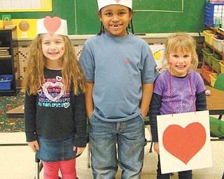 "Kindergarten students in Mrs. Bond's class at St. Patrick School in Hubbard acted out the classic children's nursery rhyme, ""The Queen of Hearts"" as part of their Valentine's Day celebrations. Classmates recited the verse while others took turns at the acting. Participating were, left to right, Ava Lengyel, Anthony Carter and Lauren Murcko."