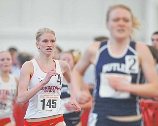 Youngstown State's Samantha Hamilton, a graduate of Jackson-Milton High, runs to the finish line behind Butler's Katie Clark to place second in the 3,000-meter run in the Horizon League indoor track championships Sunday at YSU.