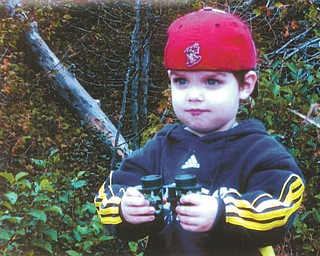 Caleb Shepperd of Toledo wears his favorite Mud Hens hat as he scopes out the wildlife while on vacation at Michigan's Upper Peninsula. He is the grandson of Frank and Vicky Hoffman of North Lima.