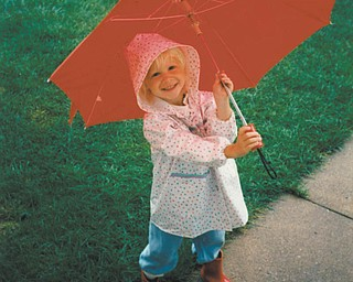 Little Ashley E. Kempe, 3, of Youngstown slipped out the back door with her new red boots and matching umbrella. (It looks to us like her boots made it on the wrong feet!)