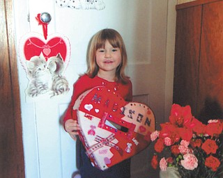 Madison Wright is showing off the valentine box she and her daddy, Jesse, made together. Photo taken by her grandma, Marilyn Cavanaugh of Columbiana.