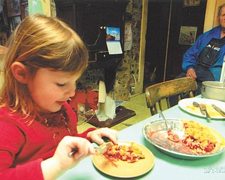 Madison Wright is enjoying a piece of cherry pie as her great granddad, John Kellner, watches to a make sure she doesn't eat it all. Photo taken by her grandma, Marilyn Cavanaugh of Columbiana.