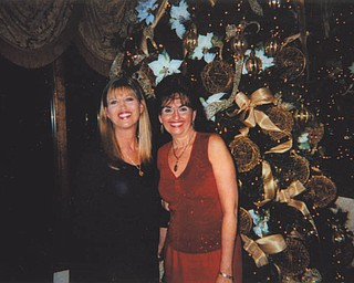 Deborah Carissimi of Boardman, in red, is pictured with her sister Carla.