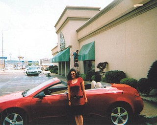 Deborah Carissimi of Boardman shows off her 2007 Pontiac G6 convertible.