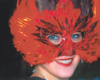 Leanna Hartsough of Canfield went to New Orleans and donned a bright feather mask. Photo from Lana VanAuker of Canfield.