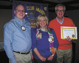 Boardman Lions Club had its Valentine Dinner on Feb. 9 at the Saxon Club in Austintown. Bill Rausch, at left, zone chairman of District 13-D, installed a new member, Gary Sobotka, right, sponsored by Lion Laura Hancock.