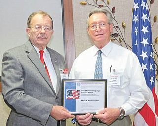 The Hon. Robert P. Milich, right, judge of Youngstown Municipal Court, is presented with the MOAA Ambassador Award from Col. Walter Duzzny, U.S.A., Ret., president of the Mahoning and Shanango Valleys Chapter of the Military Officers Association of America. Judge Milich is a retired Lt. Col. of the U.S. Air Force. The MOAA Ambassador Award is the first presented by the local chapter.