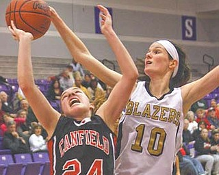 Rachel Tinkey (24) of Canfield puts up a shot against Stephanie Poland of Hathaway Brown during Tuesday's game in Barberton.
