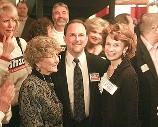 Austintown Trustee David Ditzler enjoys his victory as a Mahoning County commissioner Democratic nominee at the B&O Station. He celebrated Tuesday with his mother, Emogene, left, and wife, Jenny.