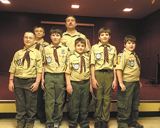 "Seven cub scouts from Webelo 2, Den 5, The Blue Wolves Den, recently participated in a crossover ceremony at the annual Blue and Gold Banquet for Cub Scout Pack 9022 at Calvary Baptist Church in Boardman. The boys who crossed over into the Boy Scout Troop are, left to right, front row, Juan Gomez, Justin Long, Anson Hankey, Alex Mazon and David Santangelo. In the back row are Michael Gombas and Den Leader Dave Santangelo, Absent is Zach Eckert. Zach, Juan, Anson, Justin, Alex and David received their Arrow of Light Award, the highest award that a Cub Scout can earn, and they also earned the ""Super Achiever"" award."