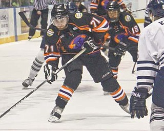 Pat Conte (71) of the Youngstown Phantoms prepares to shoot past Indiana Ice defenseman Matthew