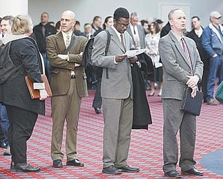 Job seekers stand in line during the Career Expo job fair Wednesday in Portland, Ore. The Labor Department said Thursday that weekly applications increased by 8,000 to a seasonally adjusted 362,000, the highest level since January.