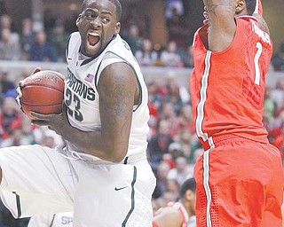 Michigan State forward Draymond Green (23) grabs a rebound against Ohio State forward Deshaun Thomas (1) in the Men's NCAA Big Ten Conference basketball final Sunday in Indianapolis. The Spartans defeated the Buckeyes, 68-64, for their first Big Ten title since 2000.