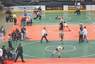 More than 800 junior high wrestlers competed Saturday and Sunday in the state tournament at the Covelli Centre. Saturday's action drew a sellout crowd.