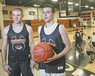 Springfield basketball seniors Ryan Stacy, left, and Tommy Mastran were in third grade the last time the Tigers won a district title. They will try to help the Tigers defeat Bedford Chanel in Wednesday's Division III regional