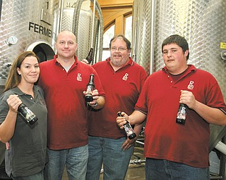 Jillian and Ken Blair, left, Brian S. Koniowsky, brewmaster, and Brian J. Koniowsky make up the small team at Rust Belt Brewing in Youngstown.