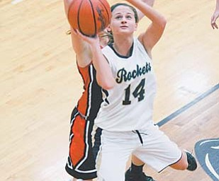 Emily Carlson (14) of Lowellville has been named to the Associated Press All-Ohio first team in girls basketball for Division IV. She averaged 14.7 points per game for the Rockets.