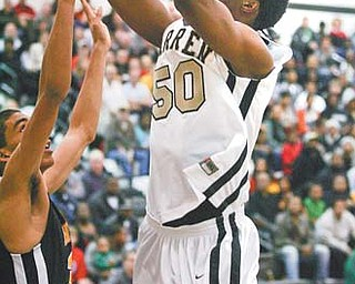Rashid Gaston (50) of Warren Harding is averaging 13 points and nine rebounds per game, both team-highs, as the Raiders prepare to play Mentor tonight in the regional tournament.