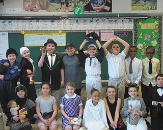 Third-grade students in Tina Takash's class at St. Patrick School in Hubbard stepped back in time to honor black history month. Each one researched a famous person in history and presented a report, while dressed as that person, to classmates, family and younger students. Shown in costume are, left to right, seated, Audra Chumley, Mia Perisa, Claire Riffle, Bri'Aja Pritchard, Kelly Novellos, Gavin Esposito and Michael Anderson. Standing are Lauren Ladd, Elizabeth Chrobak, Jeffry Hazy, Robert Mild, Joe Madeline, Daniel Rosser, Daniel Jacobs and Keilen Jacobs.
