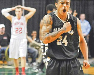 Warren Harding's Rasaun Smith thumps his chest as he walks off the court after the Raiders defeated Mentor in the Division I regional final Wednesday at Cleveland State University. With 19 seconds left to play, Smith got Mentor's Justin Fritts, background, to lose control of the ball, which he then snatched away and converted for a bucket to give the Raiders the lead and 57-54 win.