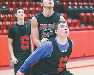 Struthers basketball players, including Austin Grewe, front, practice at Struthers High School. The Wildcats face Mentor Lake Catholic in the Division II regional semifinal tonight at Canton Civic Center.