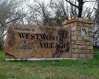 The sign for Westworth Village in North Central Texas bears the logo of Oklahoma City-based Chesapeake Energy Corp., the second-largest producer of natural gas in America.