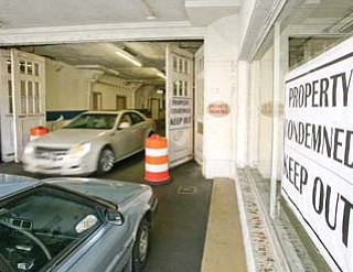 Youngstown condemned the A-1 Parking garage on West Boardman Street downtown Thursday because of structural problems.
