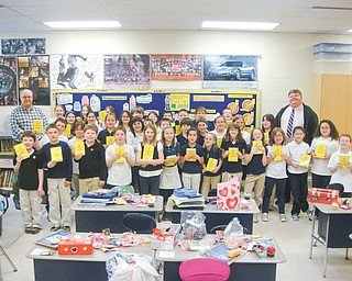 As one of its literacy projects, the Struthers Rotary Club distributes more than 300 dictionaries to all fourth-grade students in Struthers, Campbell and Lowellville. The Dictionary Project was created to provide a dictionary to each student to help with schoolwork. Rotarians Mike Evanson, far right, and Tom Baringer stand with the entire fourth-grade classes of teachers Dave Olson and Michele Perry in Lowellville with their new dictionaries.