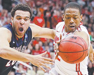 Gonzaga's Elias Harris, left, has the ball batted away by Ohio State's Lenzelle Smith during the second half of Saturday's NCAA tournament game. The Buckeyes are one of four teams from Ohio in the Sweet 16 of the NCAA men's tournament.