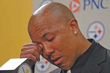 Former Pittsburgh Steelers receiver Hines Ward wipes his eye while announcing his retirement from the NFL at the Steelers' offices in Pittsburgh on Tuesday.
