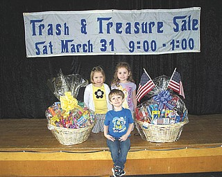Austintown Community Church Preschool Childcare Center will host its annual Trash & Treasure Sale from 9 a.m. to 1 p.m. March 31 in the upstairs auditorium of the Education Wing at Austintown Community Church, 242 S. Canfield-Niles Road. Tables are available by contacting the preschool office at 330-793-1843 through March 28. There also will be a large variety of specialty basket raffles including lawn and garden; summer fun for kids; games and family fun; arts and crafts for kids; red, white and blue; and paws and claws. Light snacks and beverages will be available for purchase. Proceeds will go toward the purchase of developmentally appropriate classroom educational materials. For information call the office from 9 a.m. to 4 p.m. Monday through Friday at the above number. Posing with specialty baskets are preschool students, from left, Abby Evans, Lee Eckonen and Jordan Corll.