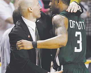 Ohio head coach John Groce embraces guard Walter Offutt (3) after the Bobcats' 65-60 win over Michigan in Round 2 of the men's NCAA basketball tournament in Nashville, Tenn. The Bobcats, who have become the tournament's latest mid-major darlings, knocked off South Florida in Round 3 to reach the Sweet 16 for the first time since 1964. They face North Carolina on Friday.