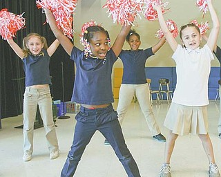 William Holmes McGuffey Elementary School second-graders Markeysha Dozier, 8, front, and from left, Jaci