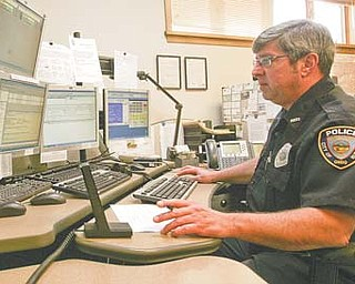 Lonny Fitzsimmons, a 911 dispatcher for Hubbard, keeps an eye on monitors connected to security cameras throughout the city. For the 2013 budget, the city is looking into options for cutting costs for 911 dispatching.
