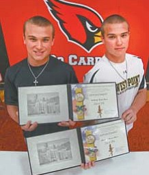 Anthony, left, and Michael Ross, 18, of Canfield signed their appointment papers Thursday to attend the U.S.