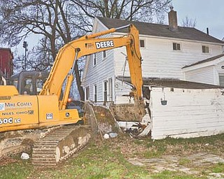 A John Deere Tractor Shovel, owned by Mike Coates Construction Co. of Niles, was stolen and used to