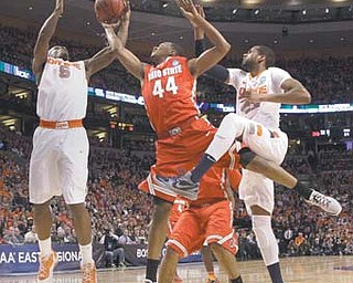 Ohio State guard William Buford (44) tries to grab a rebound between Syracuse forwards C.J. Fair (5) and James