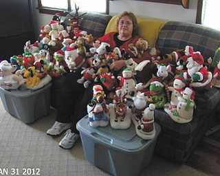 Shelly Toth shows off her collection of animated Christmas statues.